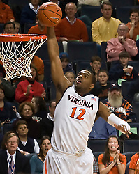 Virginia forward Jamil Tucker (12) skies for a dunk against FSU.  The Virginia Cavaliers fell to the Florida State Seminoles 73-62 in NCAA Basketball at the John Paul Jones Arena on the Grounds of the University of Virginia in Charlottesville, VA on January 24, 2009.