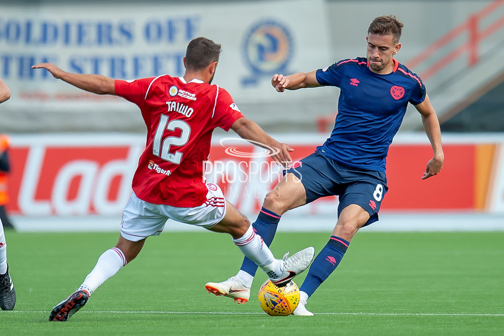 Tom Taiwo of Hamilton Academical FC tackles Olly Lee of Heart of Midlothian during the Ladbrokes Scottish Premiership League match between Hamilton Academical FC and Heart of Midlothian FC at New Douglas Park, Hamilton, Scotland on 4 August 2018. Picture by Malcolm Mackenzie.