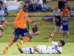 Virginia Cavaliers midfielder Tony Tchani (23) beats the slide tackle of Southern Methodist Mustangs defender Leone Cruz (5).  The #18 ranked Virginia Cavaliers fell to the #14 ranked Southern Methodist Mustangs 3-1 in NCAA men's soccer at Klockner Stadium on the Grounds of the University of Virginia in Charlottesville, VA on August 31, 2008.