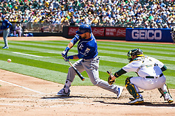 OAKLAND, CA - APRIL 17:  Alex Gordon #4 of the Kansas City Royals hits an RBI single against the Oakland Athletics during the second inning at the Oakland Coliseum on April 17, 2016 in Oakland, California. (Photo by Jason O. Watson/Getty Images) *** Local Caption *** Alex Gordon