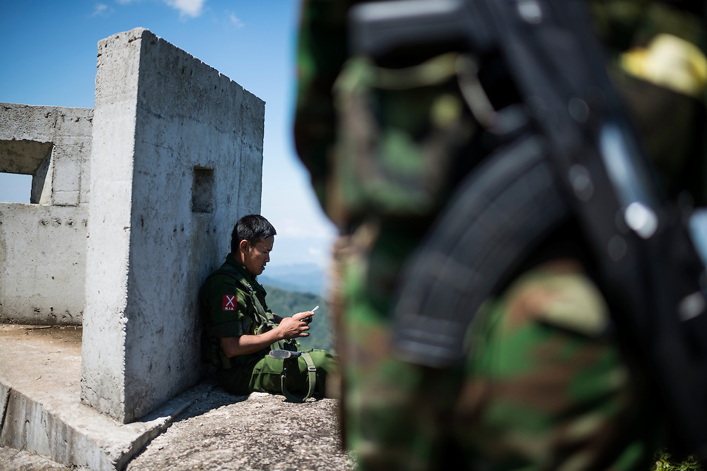 Mai Ja Yang 20160911<br /> Lieutenant Brang Seng resting against a fortification on Lagat Bom, one of the K.I.A. outposts near Mai Ja Yang in Kachin State, Myanmar.<br /> Photo: Vilhelm Stokstad / Kontinent