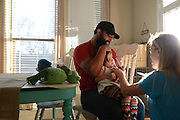Johny Hendricks and his family at their home on February 27, 2014 in Midlothian, Texas.