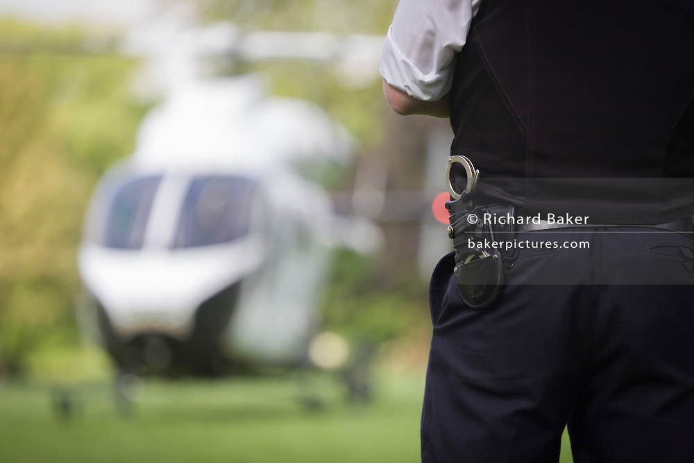 Met police and MD902 Explorer helicopter from the Kent, Surrey & Sussex Air Ambulance Trust on the ground in Ruskin Park after emergency flight to Kings College Hospital in south London.