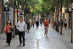 Daily life in Madrid, after new lockdown regulations in Spain, on May 02, 2020. Calle de Fuencarral in Madrid during the first day in which the general departures of almost the entire population are allowed, regulated by time bands. Two strips are established, in the morning and afternoon, so that those over 14 years old can go out to physically exercise individually or walk. These strips extend from 06:00 to 10:00 in the morning and from 20:00 to 23:00 at night. Separately and in attention to their special vulnerability, the strips between 10:00 a.m. and 12:00 p.m. and between 7:00 p.m. and 8:00 p.m. are defined specifically for the walks of people with special needs or those over 70 years. The walks with kids from 12:00 to 19:00. Health crisis due to the Covid-19 virus pandemic. Photo by Alejandro de Dios/AlterPhotos/ABACAPRESS.COM