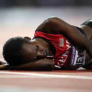 Milcah Chemos Cheywa, Kenya, collapsed over the finish line after finishing fourth in the Women's 3000m Steeplechase, winning the Women's Pole Vault Final at the Olympic Stadium, Olympic Park, during the London 2012 Olympic games. London, UK. 4th August 2012. Photo Tim Clayton