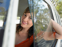 Young Woman looking through van window half length