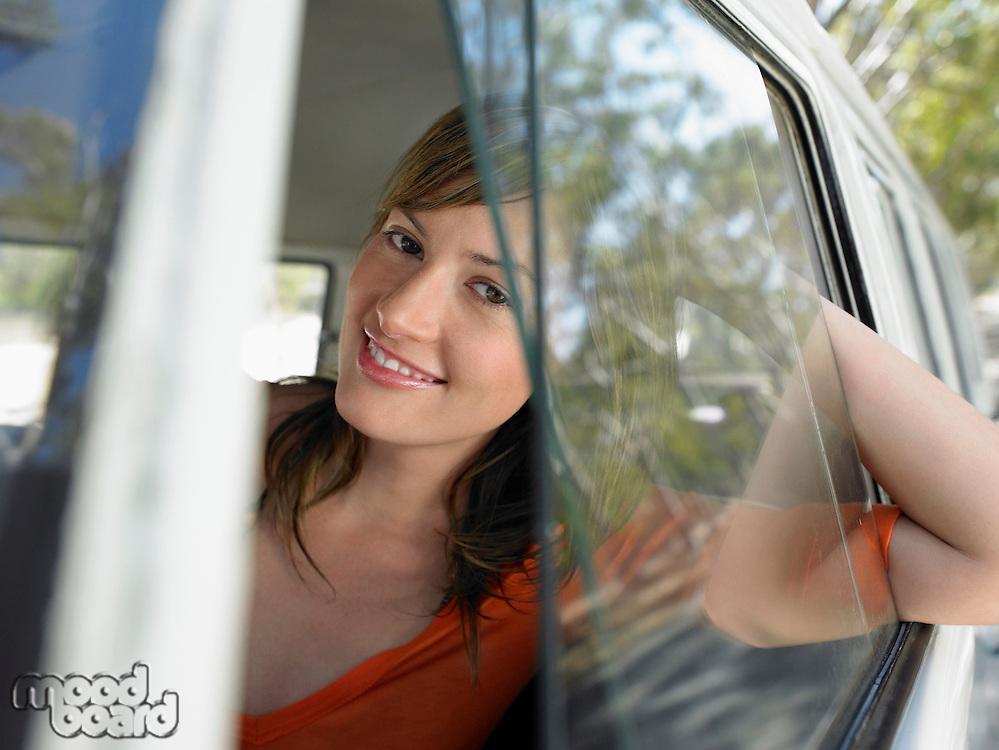 Young Woman looking through van window half length