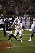 Oakland Raiders defensive end Bruce Irvin (51) chases and strips Los Angeles Rams quarterback Jared Goff (16) of the ball, recovered by the Rams, on a second quarter sack for a loss of 9 yards to the Raiders 29 yard line during the 2018 regular season week 1 NFL football game against the Los Angeles Rams on Monday, Sept. 10, 2018 in Oakland, Calif. The Rams won the game 33-13. (©Paul Anthony Spinelli)