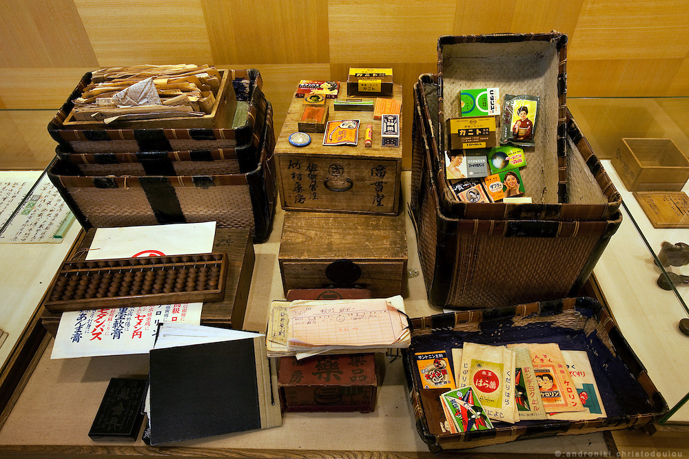 "TOYAMA MEDICINETraditional medicne-boxes and their incredients at the museum of Kokando traditional medicine company, one of the oldest medicine in Toyama, city founded in 1876. Medicines manufactured in Toyama spread by medicine peddlers who were called ""Baiyaku-san"". They traveled all over Japan bringing medicine boxes to their clients, employing a unique business style known as ""Senyo-kori"" (Use first, and pay later service), in which a box filled with medicines is placed at customer's home free of charge, and later the customer pays for actual consumption. Today, a lot of Baiyaku-san are still active in Japan.Toyama prefecture is located near the center of Japan and is approximately the same distance from the three largest cities in Japan-Tokyo, Nagoya and Osaka. Toyama's pharmaceutical tradition has a more than 300 years history. As it is located on the Japan sea, it is facing China and has been an importer of traditional Chinese medicine knowledge which it developed through the years. There are now approximately 100 manufactures and over 100 factories in Toyama in terms of pharmaceutical products and Toyama prefecture acquires a steady reputation as Japan's medicine manufacturing base."