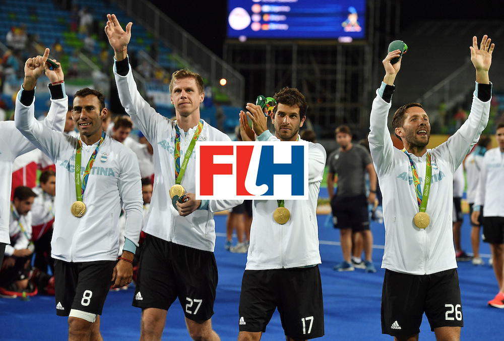 (From L) Argentina's Lucas Rey, Argentina's Lucas Rossi, Argentina's Juan Lopez and Argentina's Agustin Mazzilli celebrate with their gold medals during the men's field hockey medals ceremony of the Rio 2016 Olympics Games at the Olympic Hockey Centre in Rio de Janeiro on August 18, 2016. / AFP / Pascal GUYOT        (Photo credit should read PASCAL GUYOT/AFP/Getty Images)