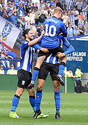 Barry Bannan celebrates his goal with George Boyd and Michael Hector during the EFL Sky Bet Championship match between Sheffield Wednesday and Bristol City at Hillsborough, Sheffield, England on 22 April 2019.