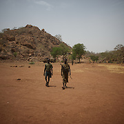 May 02, 2012 - Kauda, Nuba Mountains, South Kordofan, Sudan: Sudan People?s Liberation Movement (SPLA-N) rebel fighters walk by in Jebel Kwo military base near Tess village in the rebel-held territory of the Nuba Mountains in South Kordofan. ..SPLA-North, a historical ally of SPLA, South Sudan's former rebel forces, has since last June being fighting the Sudanese Army Forces (SAF) over the right to autonomy and of the end of persecution of Nuba people by the regime of President Bashir. (Paulo Nunes dos Santos/Polaris)