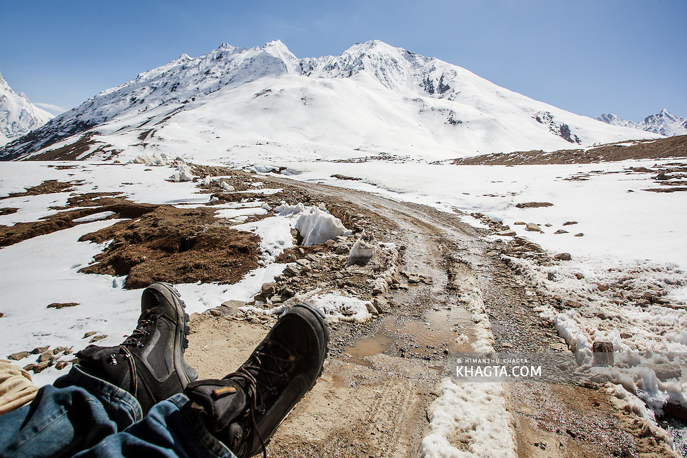 Amit Chaudhary rests while the tractor descends from Pensi La towards Padum, Zanskar...In May 2012, Fox Adventure Club set a record for the Longest Tractor Expedition, when three members covered 3623 kms across the western Himalayas in just 14 days on a 65hp Farm Tractor.