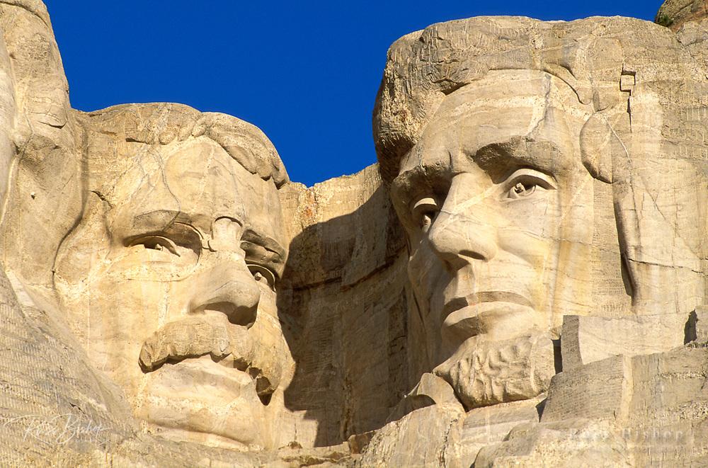 Morning light on Lincoln and Roosevelt detail, Mount Rushmore National Memorial, South Dakota USA