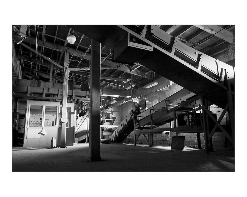 Conveyor System, O'Brien Warehouse, Second Floor, 2006.After tobacco was conditioned and stored in bulkers on the second floor of O'Brien, it was loaded onto a system of conveyer belts, carried over Main Street and lifted to the sixth floor of the New Cigarette Factory for casing and cutting. Although Bull Durham Tobacco Company was the first major tobacco company in Durham, with around 900 employees in 1884, it was James B. Duke's focus on innovative methods of cigarette production that quickly propelled Washington Duke & Sons (later the American Tobacco Company) to become the world wide leader in cigarette manufacturing at the turn of the 20th century.