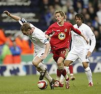 Photo: Aidan Ellis.<br /> Bolton Wanderers v Blackburn Rovers. The Barclays Premiership. 04/03/2007.<br /> Blackburn's Morten Gamst Pedersen (R) catches Bolton's Kevin Nolan