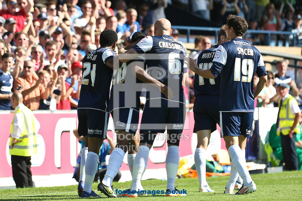 Picture by David Horn/Focus Images Ltd +44 7545 970036.08/09/2012.Britt Assombalonga (2nd left) of Southend United celebrates scoring the opening goal during the npower League 2 match at Roots Hall, Southend