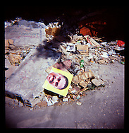A poster for Haitian presidential candidate Jude Celestin, torn by protesters from a light pole, sits torn on a pile of trash and rubble on Wednesday, November 24, 2010 in Port-au-Prince, Haiti.