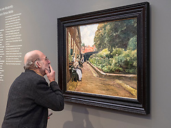 Visitor looking at painting, Stevenstift in Leiden by Max Liebermann,   at new Museum Barberini in Potsdam Germany