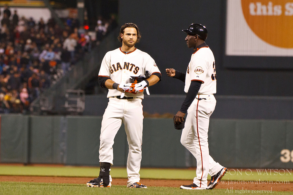 SAN FRANCISCO, CA - JULY 23: Brandon Crawford #35 of the San Francisco Giants (left) reacts next to first base coach Roberto Kelly #39 after getting ejected from the game by first base umpire Jordan Baker #71 (not pictured) during the eighth inning at AT&T Park on July 23, 2012 in San Francisco, California. The San Francisco Giants defeated the San Diego Padres 7-1. (Photo by Jason O. Watson/Getty Images) *** Local Caption *** Brandon Crawford; Roberto Kelly