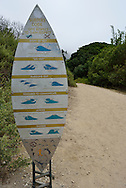Surfer's Code at beach access trail just off the Pacific Coast Highway (US 101) near Carpinteria, California.