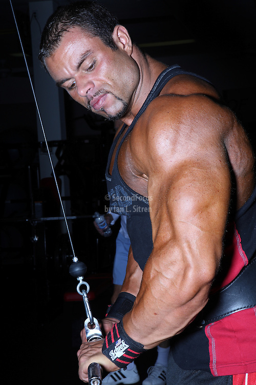 IFBB Pro Bodybuilder Daniel Hill doing cable trip push downs.