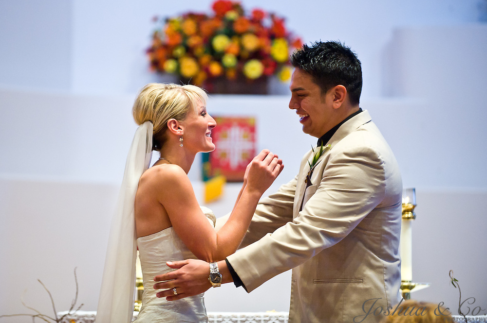 Kevin Ortiz and Jessica Lowe are married at the Shrine of St. Therese in Pueblo, Colorado, on Saturday, Oct. 22, 2011. The reception was held at the Pueblo Union Depot. ..Photo by Joshua Lawton /  / Joshua & Co. Photography..www.joshuacophotography.com