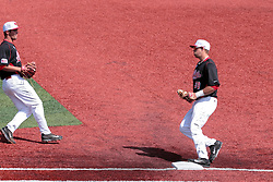 26 April 2014:   Brian Rodemoyer fields a ball deep behind first and cover 1st himself to put out Jake Welch during an NCAA Division 1 Missouri Valley Conference (MVC) Baseball game between the Southern Illinois Salukis and the Illinois State Redbirds in Duffy Bass Field, Normal IL