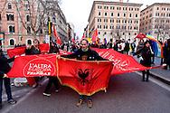 Roma, 14 Febbraio  2015<br /> Manifestazione di solidarietà con la Grecia di Alexis Tsipras e contro le politiche di austerity imposte dalla troika. Manifestante con la bandiera dell'Albania<br /> Rome, February 14, 2015<br /> Demonstration of solidarity with Greece  of Alexis Tsipras and against austerity policies imposed by the Troika. Protestor with the flag of Albania