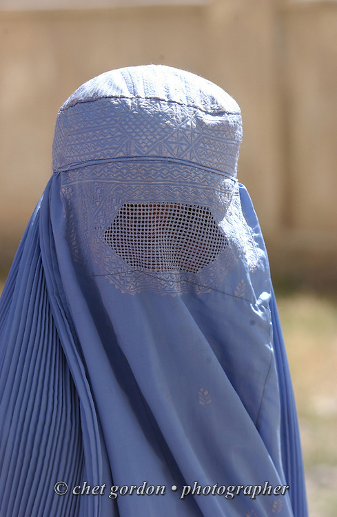 "An Afghan woman dressed in the traditional burka waits to enter the Charasyab health clinic approximately 20 kilometers outside of Kabul, Afghanistan on Sunday, May 26, 2002. A humanitarian mission organized by The Geshundheit Instititute, founded by Dr. Hunter ""Patch"" Adams, Lufthansa Cargo, and DHL Worldwide Express collaborated to ship medicines, food and orthopedic supplies to the Indira Ghandi Children's Hospital, clinics and orphanages in Kabul. The German NGO (Non Governmental Organization) Hammer Forum supervised the distribution of the donated supplies from various non-profit organizations in the U.S. and The Netherlands."