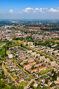 Nederland, Noord-Brabant, Den Bosch, 27-05-2013; Plan Zuid / De Pettelaar. Foto richting centrum. Stadsuitbreiding en nieuwbouwwijk uit de jaren vijftig en zestig van de vorige eeuw, wederopbouwperiode. Groen en ruim opgezet.<br /> New residential area built in the fifties and sixties in Den Bosch. Spacious and plentyful green areas.<br /> Reconstruction area.<br /> luchtfoto (toeslag op standard tarieven)<br /> aerial photo (additional fee required)<br /> copyright foto/photo Siebe Swart