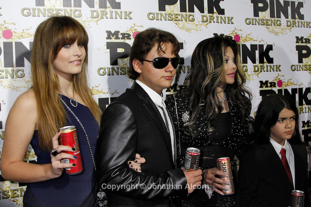 Paris Jackson (L), Prince Michael Jackson, La Toya Jackson, and Blanket Jackson arrive at the Mr. Pink Ginseng Drink launch party at the Beverly Wilshire Hotel in Beverly Hills, California, October 11, 2012. Jonathan Alcorn/JTA/Uber.