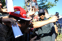 Lewis Hamilton (GBR) Mercedes AMG F1 signs autographs for the fans.<br /> Italian Grand Prix, Saturday 6th September 2014. Monza Italy.