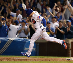 August 30, 2017 - Chicago, IL, USA - The Chicago Cubs' Ian Happ rounds the bases after his two-run home run against the Pittsburgh Pirates during the third inning at Wrigley Field in Chicago on Wednesday, Aug. 30, 2017. (Credit Image: © Nuccio Dinuzzo/TNS via ZUMA Wire)