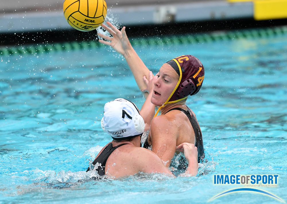 Southern California Trojans driver Elise Stein (14) is defended by Wagner Seahawks attacker Erica Hardy (7)during an NCAA college women's water polo quarterfinal game in Los Angeles, Friday, May 11, 2018. USC defeated Wagner 12-5.  (Kirby Lee via AP)