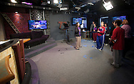 Trinity Renchin, student ambassador, leads a tour of prospective students and their parents during an open house in the TV studio at Waldorf College in Forest City, Iowa on Saturday, May 14, 2011.