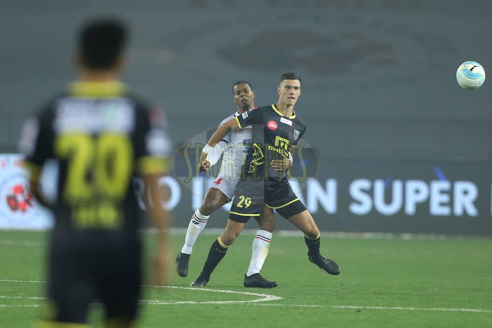 Rowilson Rodrigues of Delhi Dynamos FC and Mark Sifneos of Kerala Blasters FC in action during match 43 of the Hero Indian Super League between Delhi Dynamos FC and Kerala Blasters FC  held at the Jawaharlal Nehru Stadium, Delhi, India on the 10th January 2018<br /> <br /> Photo by: Arjun Singh  / ISL / SPORTZPICS