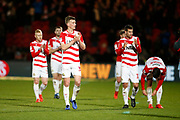 Doncaster players applaud the fans at full time during the EFL Sky Bet League 1 match between Doncaster Rovers and Barnsley at the Keepmoat Stadium, Doncaster, England on 15 March 2019.