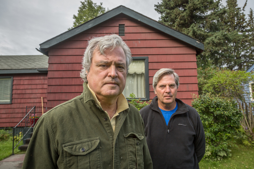 """We've always wanted to fix this place up...but it's a slow process.""  -Brothers George and David Freeman stand in front of their home in Anchorage, Alaska."