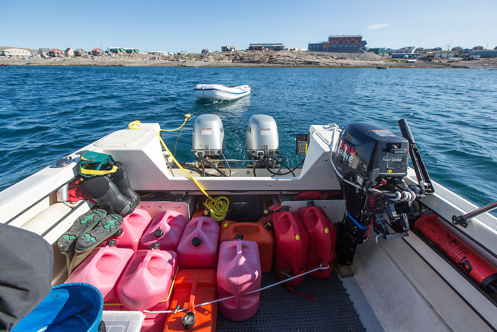 Canada, Nunavut Territory, Repulse Bay, Fuel cans fill cockpit of expedition C-Dory boat anchored near Arctic Circle