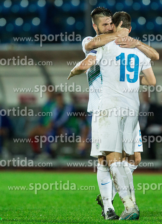 Bostjan Cesar of Slovenia and Nejc Pecnik of Slovenia celebrate after Pecnik scored second goal for Slovenia during football match between National teams of San Marino and Slovenia in Group E of EURO 2016 Qualifications, on October 12, 2015 in Stadio Olimpico Serravalle, Republic of San Marino. Photo by Vid Ponikvar / Sportida