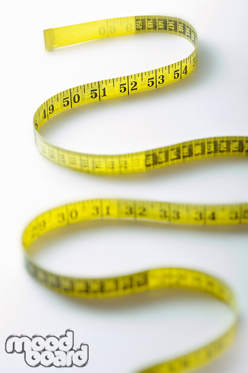 Winding strip of measuring tape close-up