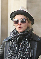 ©London News Pictures. 15/01/2011. Picture Credit Should read Neil Hall/London News Pictures.Madonna directs her new period film W.E. starring Abbie Cornish about the abdication of King Edward in London on 08/08/2010. Image of Madonna wearing hat and sunglasses