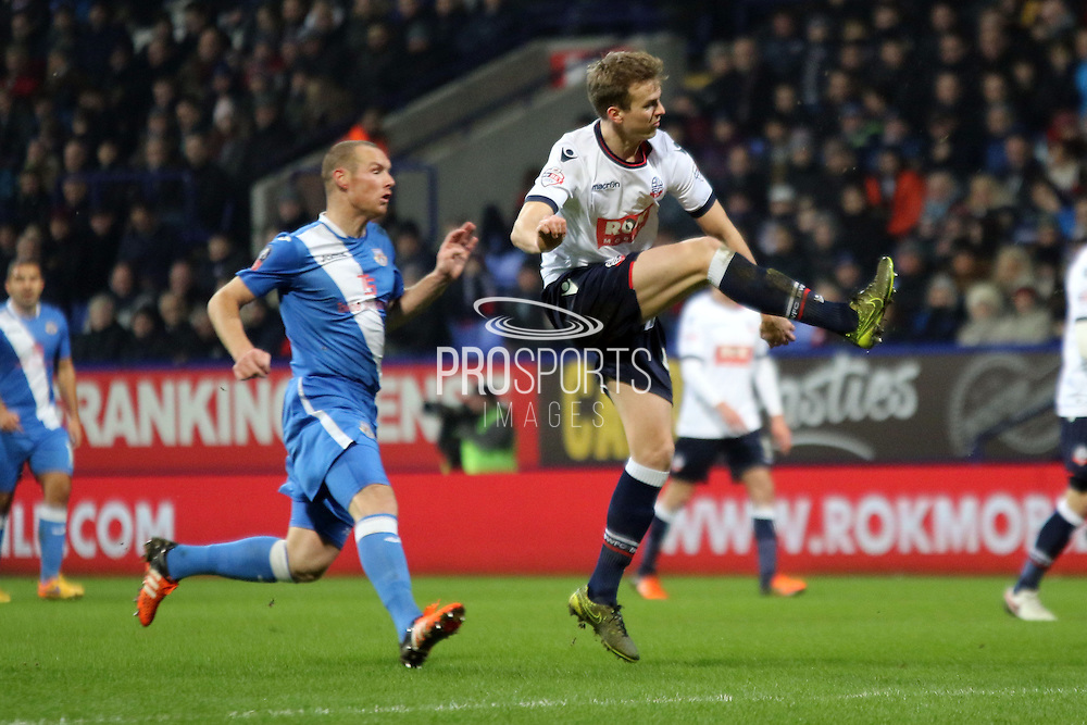 Rob Holding clears during the The FA Cup Third Round Replay match between Bolton Wanderers and Eastleigh at the Macron Stadium, Bolton, England on 19 January 2016. Photo by Pete Burns.