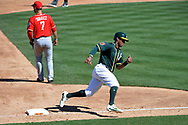 MESA, AZ - MARCH 09:  Khris Davis #2 of the Oakland Athletics rounds third base to score against the Cincinnati Reds in the third inning of the spring training game at HoHoKam Stadium on March 9, 2017 in Mesa, Arizona.  (Photo by Jennifer Stewart/Getty Images)