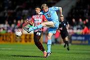 Morecambe's Andy Parrish clears the ball away from Exeter City's Jayden Stockley during the Sky Bet League 2 match between Exeter City and Morecambe at St James' Park, Exeter, England on 30 April 2016. Photo by Graham Hunt.