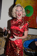 KITTY LA ROAR, Dinner in aid of the China Tiger Revival hosted by Sir David Tang and Stephen Fry  at China Tang, Park Lane, London. 1 October 2013. ,