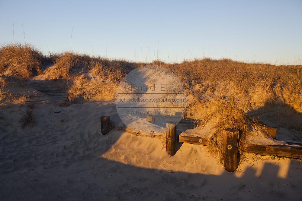 Sand dunes during sunrise over Folly Beach near Charleston, SC.