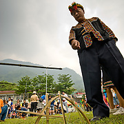 Mayor istanda inspects snare in snare making contest at Bunong Aboriginal Tribe Ear Festival, Namasiya Township, Kaohsiung County, Taiwan.  April 26th 2008