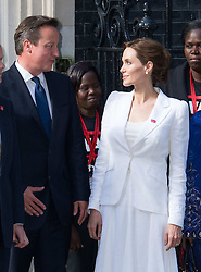 Image ©Licensed to i-Images Picture Agency. 10/06/2014. London, United Kingdom. In the frame - Angelina Jolie with David Cameron. <br /> Angelina Jolie meets with Prime Minister David Cameron and Foreign Secretary William Hague as part of theGlobal Summit to End Sexual Violence in Conflict global summit, at at 10 Downing Street. Picture by Nils Jorgensen / i-Images